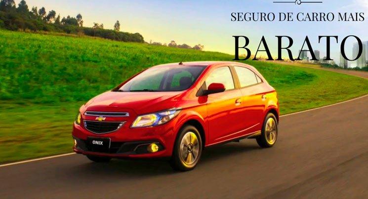 """Imagem do carro Ônix vermelho com a legenda """"seguro de carro barato"""" seguro mais barato"""