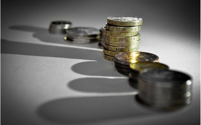 Imagem de moedas para ilustrar post sobre o que é score
